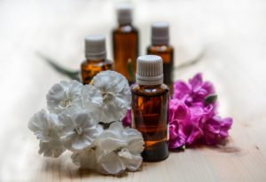 Photo of aromatherapy oils and flowers
